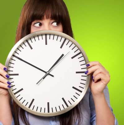 woman with clock to illustrate point for web copywriting article