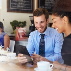 Businessman And Businesswoman Meeting In Coffee Shop