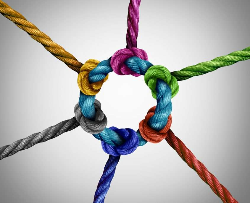colorful ropes linked around a core as a metaphor for creating website backlinks
