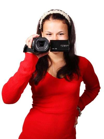 picture of woman with camcorder for youtube seo webinar